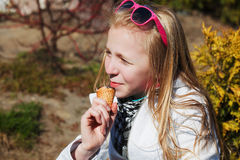 Girl with ice cream. Teenage girl with an ice cream in a city park Royalty Free Stock Photography