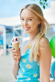 Girl with ice cream. On the street Royalty Free Stock Photography