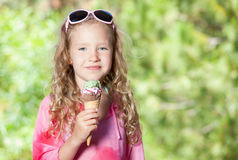 Girl with ice cream. Happy little girl with ice cream outdoors Stock Photo