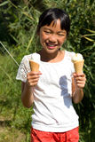 Girl with ice cream. Little girl with two vanilla ice cream Stock Photos