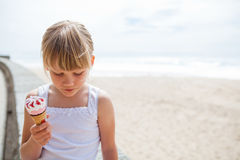 Girl with ice cream near beach Stock Photos