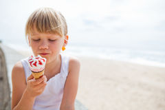 Girl with ice cream near beach Royalty Free Stock Photo