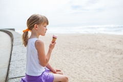Girl with ice cream near beach Royalty Free Stock Images