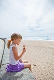 Girl with ice cream near beach Royalty Free Stock Photos
