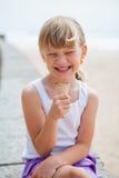 Girl with ice cream near beach Stock Photography