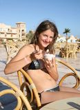 Girl with ice-cream at resort Royalty Free Stock Photos