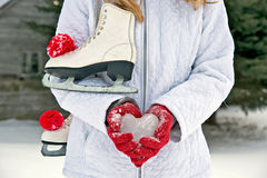 Girl with ice heart and skates Royalty Free Stock Photo