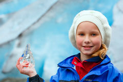 Girl with ice piece near Nigardsbreen glacier (Norway) Royalty Free Stock Images