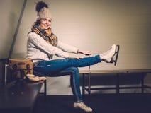 Girl in ice rink locker room Stock Photos