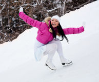 Girl ice skating Stock Images