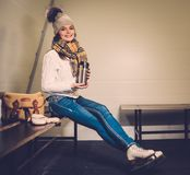 Girl in ice-skating locker room Stock Photo