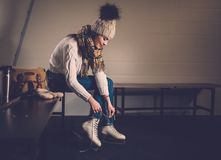 Girl in ice-skating locker room Stock Photos