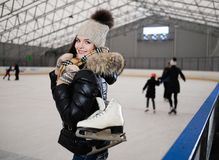 Girl on ice skating rink. Cheerful girl with skates on ice skating rink Stock Photography