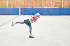 Girl ice skating on rink stock photo