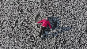 Girl ice skating roll on a frozen huge pond. View from above. Snc with a quadcopter stock video
