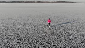 Girl ice skating roll on a frozen huge pond. View from above. Snc with a quadcopter stock footage