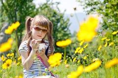 Girl with icecream. Little girl in sunglasses eating icecream Stock Photography
