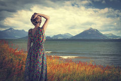 Girl in Iceland is in a dress Royalty Free Stock Photography
