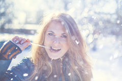 Girl with icicle Stock Photo