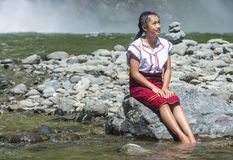 Girl from Ifugao ethnic minority in the Philippines. BATAD, PHILIPPINES - MAY 02 : Girl from Ifugao Minority near a waterfall in Batad the Philippines on May 02 Royalty Free Stock Photo