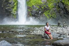 Girl from Ifugao ethnic minority in the Philippines. BATAD, PHILIPPINES - MAY 02 : Girl from Ifugao Minority near a waterfall in Batad the Philippines on May 02 Royalty Free Stock Image