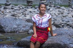 Girl from Ifugao ethnic minority in the Philippines. BATAD, PHILIPPINES - MAY 02 : Girl from Ifugao Minority near a waterfall in Batad the Philippines on May 02 Royalty Free Stock Images