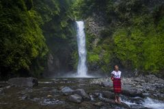 Girl from Ifugao ethnic minority in the Philippines. BATAD, PHILIPPINES - MAY 02 : Girl from Ifugao Minority near a waterfall in Batad the Philippines on May 02 Stock Photo
