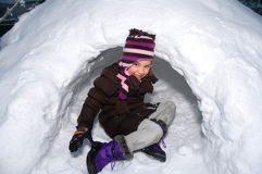 Girl in an igloo Stock Image