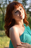 Girl illuminated by the sun. Red-haired girl in the sun Royalty Free Stock Photography
