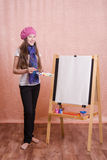 The girl in image of  artist at easel Stock Photography