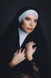 A girl in the image of a nun Royalty Free Stock Photo