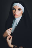 A girl in the image of a nun Stock Photography
