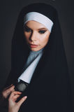A girl in the image of a nun Stock Image