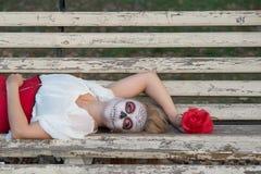The girl in the image of Santa Muerte Stock Image