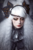 Girl in the image of  witch with a lush white Royalty Free Stock Photography