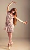 Girl imagine herself as a ballerina Stock Photos