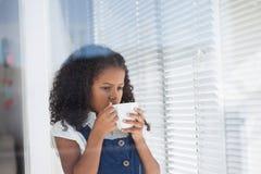Girl imitating as businesswoman having coffee Stock Photography