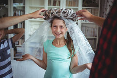 Girl imitating to be an angel by wearing a bubble wrap and an unpacked ring Royalty Free Stock Photo