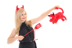 Girl in imp costume with bull Royalty Free Stock Photography