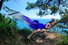 Girl In A Hammock On A Tropical Coast Stock Images