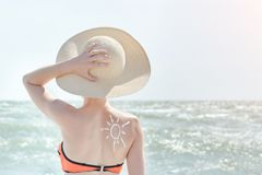 Free Girl In A Hat Against Sea. On The Back Is Painted Sun Stock Image - 113142831