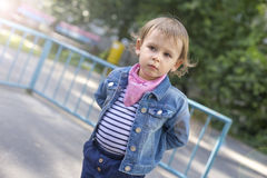 Girl In A Jeans Jacket Draws With Colored Chalks Stock Images