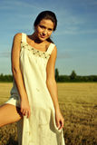 Girl In A Rural Clothing Standing On The Field Royalty Free Stock Photos
