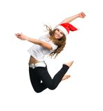 Girl In A Santa Hat Jump Royalty Free Stock Photography
