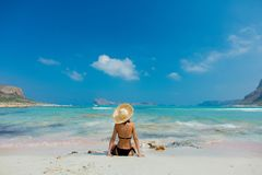 Girl In Black Bikini And With Hat On Balos Beach Royalty Free Stock Photography