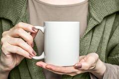 Girl In Black Dress Is Holding White Mug. Mockup For Halloween Gifts Design. Stock Images