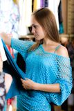 Girl In Blue Blouse Is Shopping Stock Images