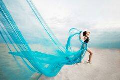 Free Girl In Desert With Slim Body, Blue Sky And Tulle, Royalty Free Stock Photos - 188959838