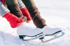 Girl In Dress Skates Mittens Tying Shoelaces