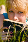 Girl In Grass With Book Stock Photo
